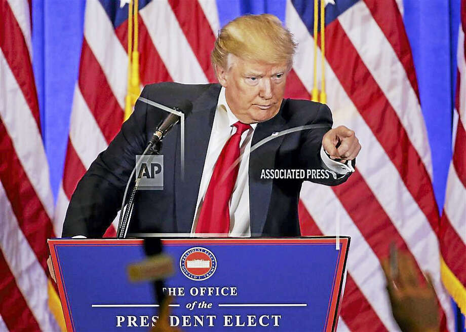 President-elect Donald Trump takes questions during a news conference, Wednesday, Jan. 11, 2017, in New York. The news conference was his first as President-elect. Photo: AP Photo/Seth Weni