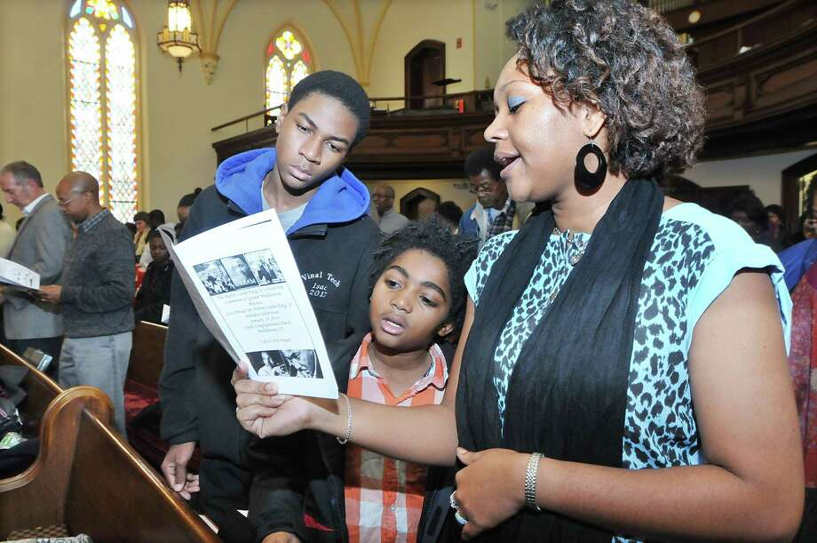 Quatina Frazer and two of her three sons, Isac Frazer and Elijah Frazer, sing at the 21st annual Dr. Martin Luther King Jr. birthday celebration at South Congregational Church in Middletown three years ago. Photo: File Photo  / TheMiddletownPress