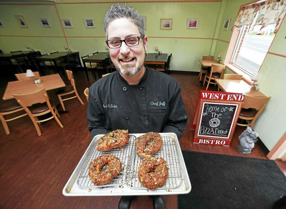 Jeff Lamberti, chef/owner of the West End Bistro, is photographed with Pizza Donuts at the West Haven restaurant Tuesday. Photo: Arnold Gold — New Haven Register