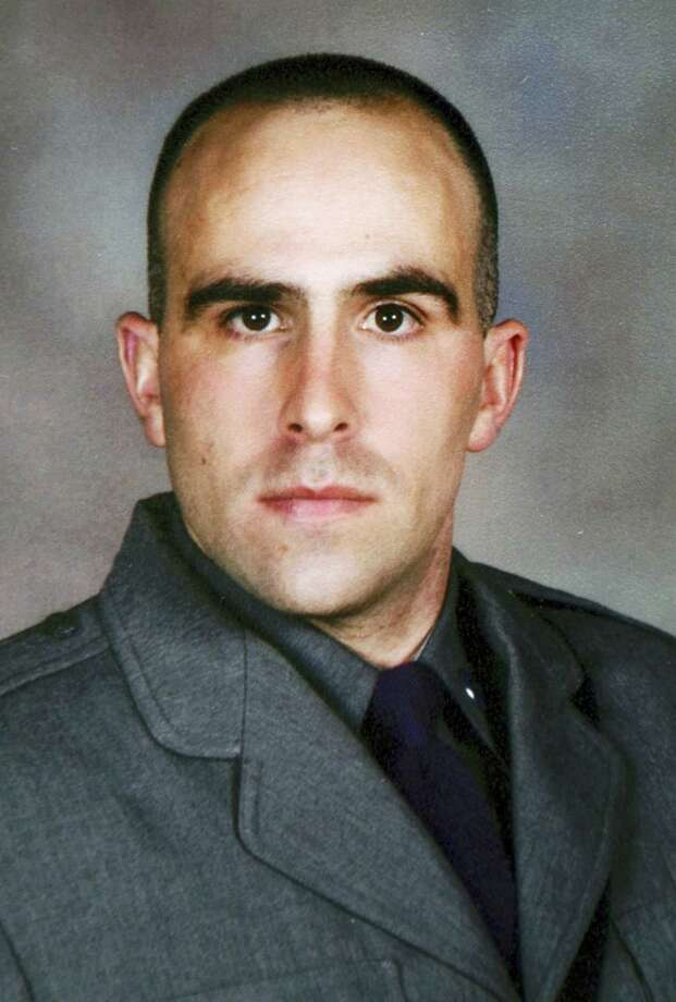 This undated photo provided by the New York State Police shows Trooper Joel Davis, who was fatally shot responding to a domestic dispute in Theresa, N.Y., on Sunday, July 9, 2017. Justin Walters, a U.S. Army soldier, was charged Monday, July 10 with murder in the shooting. (New York State Police via AP) Photo: AP / Copyright 2017 The Associated Press. All rights reserved.