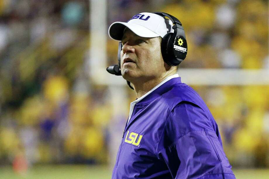 This Sept. 17, 2016 photo shows LSU head coach Les Miles watching from the sideline in the second half of an NCAA college football game against Mississippi State in Baton Rouge, La.  Miles spent national signing day doing television on ESPNU on Feb. 1, 2017 as his son, Ben Miles,  officially became a college football player. Photo: AP Photo/Gerald Herbert, File  / Copyright 2017 The Associated Press. All rights reserved.