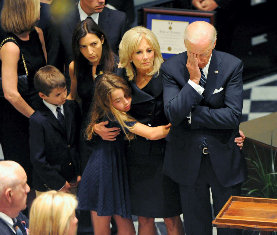 Vice President Joe Biden, right, rests his head in his hand during a viewing for his son, former Delaware Attorney General Beau Biden on June 4, 2015 at Legislative Hall in Dover, Del. Standing with Biden are Beau Biden's widow, Hallie, from left, granddaughter Natalie and wife Jill. Beau Biden died of brain cancer Saturday at age 46. Photo: Jason Minto/The Wilmington News-Journal Via AP  / The Wilmington News-Journal