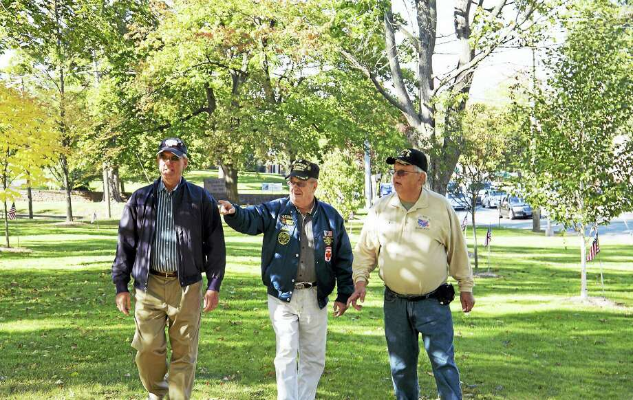 Members of the Greater Middletown Military Museum Project inspect the commemorative trees that honor fallen World War One soldiers. Left to Right: Ken McClellan, Mike Rogalsky and Ron Organek. Photo: Bob Crawshaw Photo