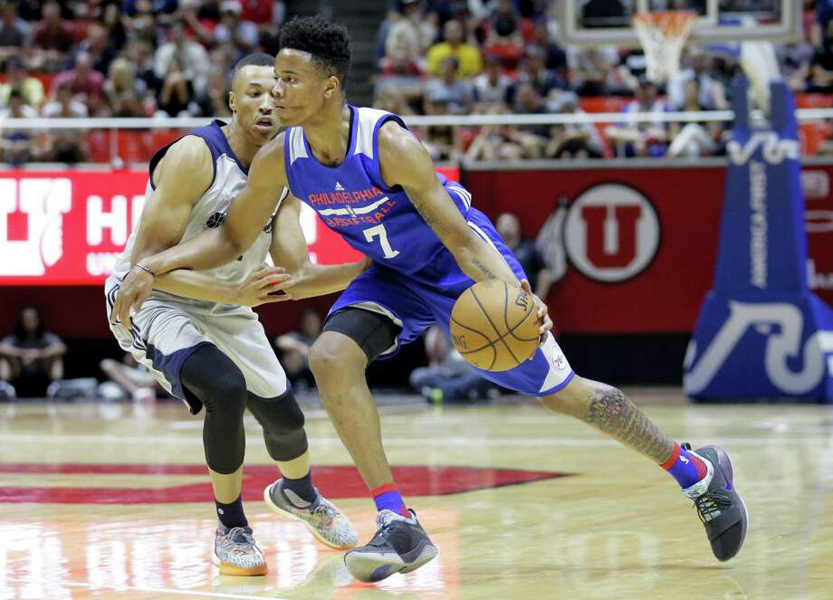In this Wednesday, July 5, 2017 photo, Philadelphia 76ers guard Markelle Fultz (7) drives around Utah Jazz guard Dante Exum during the first half of an NBA summer league basketball game in Salt Lake City. Fultz needed to be helped off the court with an injury to his left ankle in the 76ers' summer league game Saturday, July 8, against Golden State. Photo: AP Photo — Rick Bowmer, File  / Copyright 2017 The Associated Press. All rights reserved.