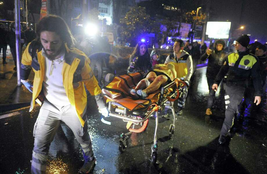 In this Jan. 1, 2017 photo, medics carry a wounded person at the scene after an attack at a popular nightclub in Istanbul. As violence has escalated in nearby Syria, and after a deadly nightclub attack in a neighborhood where some players celebrated on New Year's Eve in Istanbul, a handful of WNBA players told The Associated Press they want to come back to the U.S. as soon as possible. They spoke on condition of anonymity because of the sensitive nature of contract negotiations and out of fear they could become targets if they said publicly they wanted to leave. Photo: IHA Via AP, File  / IHA