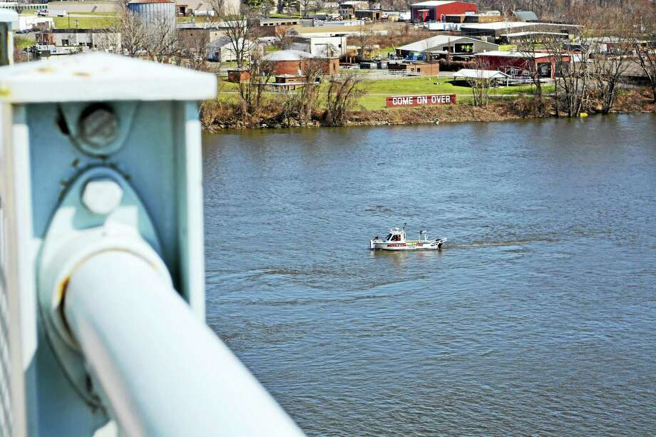 Middletown police and fire crews were dispatched to the Arrigoni Bridge Tuesday at about 2 p.m. on the report of a man who allegedly jumped into the water. Photo: Cassandra Day — The Middletown Press