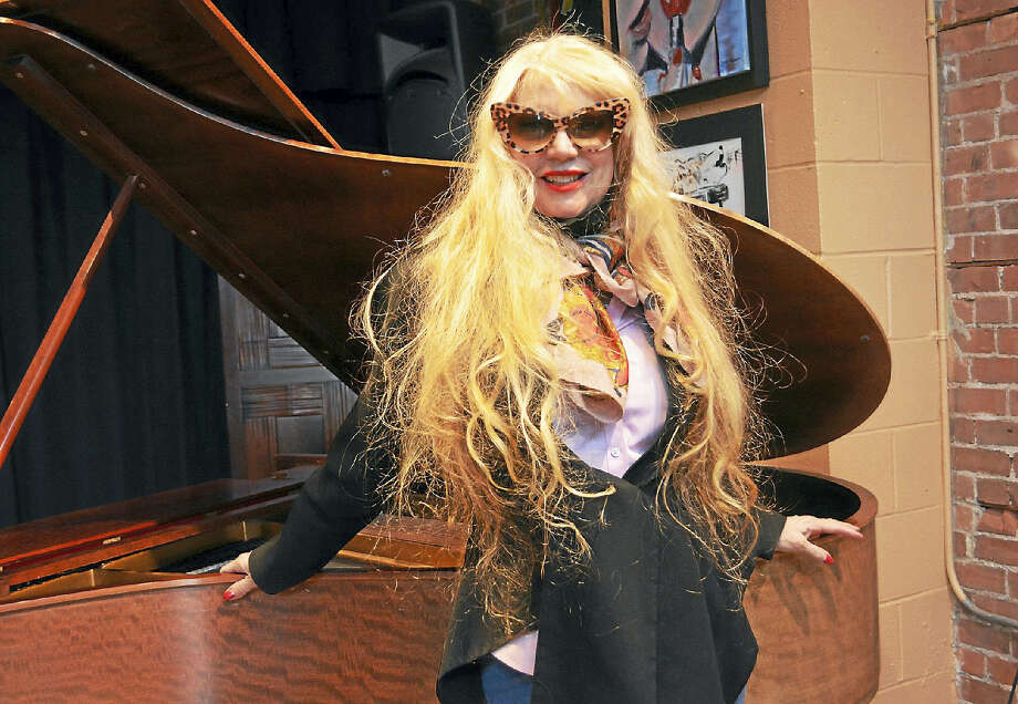 "Pianist and artist Phoebe Legere, executive director of the Foundation for New American Art in New York City, whose art is on view at The Buttonwood Tree on Main Street in Middletown this month, will also ""tickle the keys"" of the old Steinway there May 20. Photo: Cassandra Day — The Middletown Press"