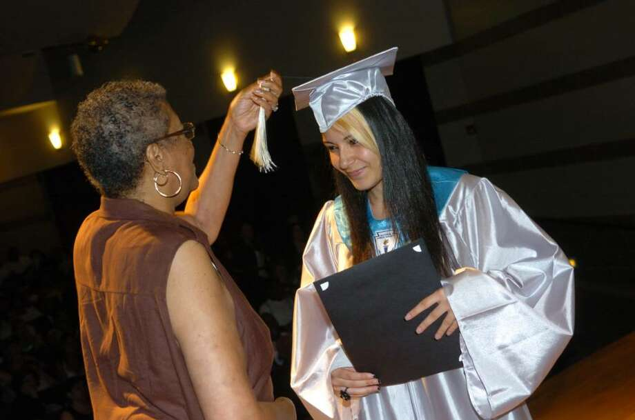 Highlights from Bridge Academy's 13th Annual Commencement Exercises held at Thurgood Marshall Middle School in Bridgeport, Conn. on Wednesday evening June 16, 2010. Here, Dean of Students Aline Doss, left, turns the tassel of graduate Cynthia Ramos. Photo: Christian Abraham / Connecticut Post