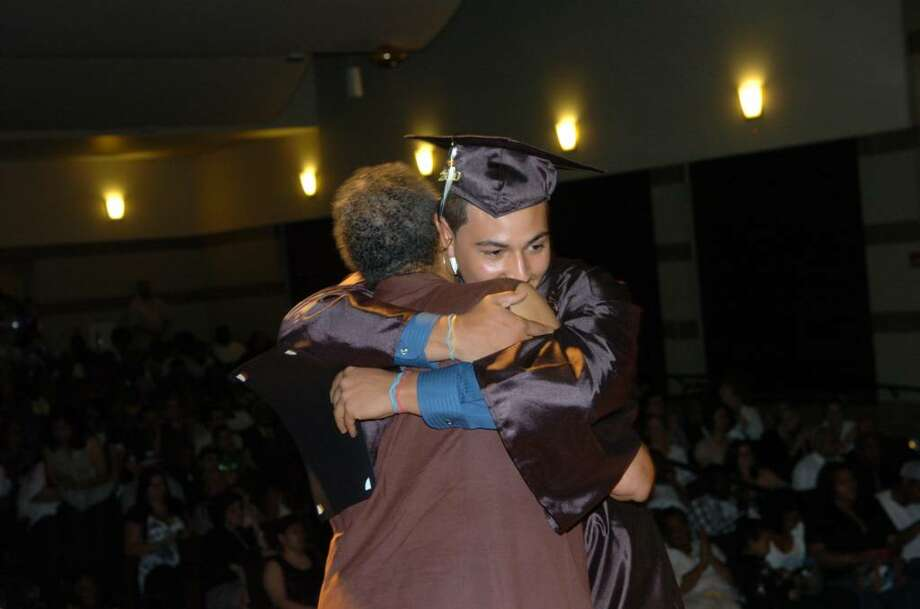 Highlights from Bridge Academy's 13th Annual Commencement Exercises held at Thurgood Marshall Middle School in Bridgeport, Conn. on Wednesday evening June 16, 2010. Here, Dean of Students Aline Doss gets a big hug from graduate Nathaniel Rosa. Photo: Christian Abraham / Connecticut Post
