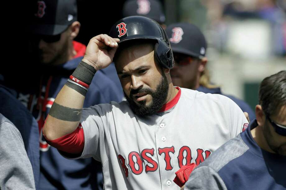 Boston Red Sox's Sandy Leon enters the dugout after scoring from third on a single by Marco Hernandez during the second inning of a baseball game against the Detroit Tigers on April 9, 2017 in Detroit. Photo: AP Photo — Carlos Osorio  / Copyright 2017 The Associated Press. All rights reserved.