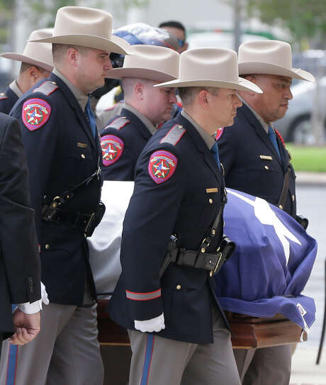 Texas Dept. Public Safety Honor Guard members escort the casket into the memorial service for former Texas Governor Mark White at Second Baptist Church, 6400 Woodway, Wednesday, August 9, 2017. ( Melissa Phillip / Houston Chronicle ) Photo: Melissa Phillip, Staff / © 2017 Houston Chronicle