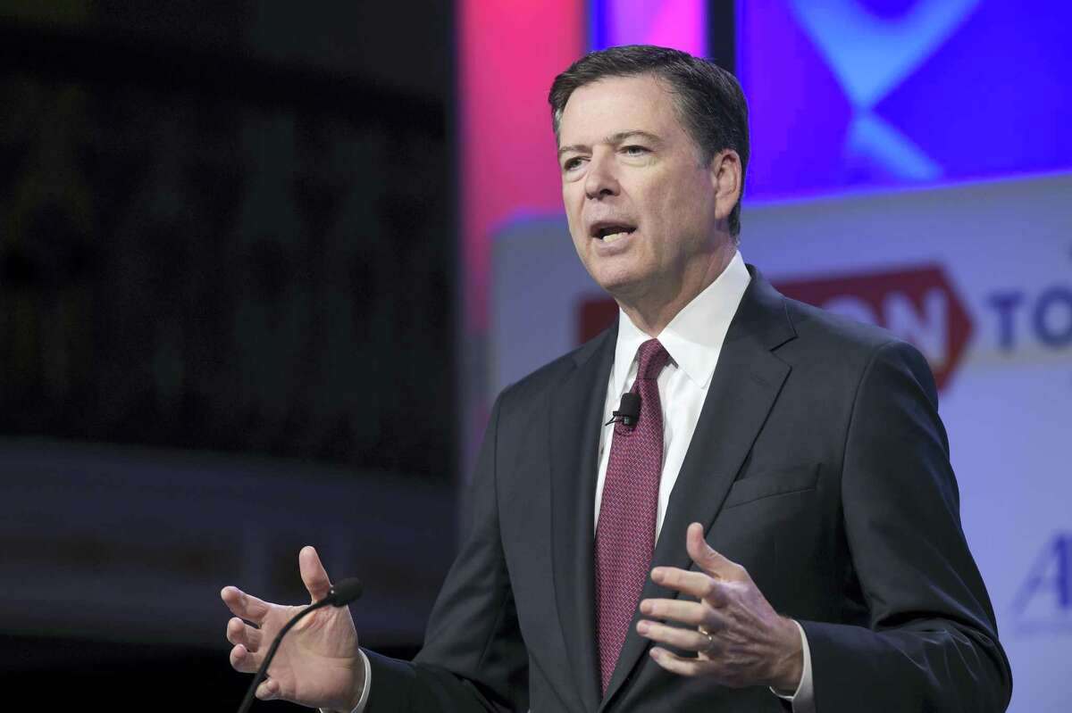 """In this photo taken May 8, 2017, FBI Director James Comey speaks in Washington. A person familiar with the investigation into Hillary Clinton's use of a private email server says Huma Abedin did not forward """"hundreds and thousands"""" of emails to her husband's laptop, as FBI Director James Comey testified to Congress."""