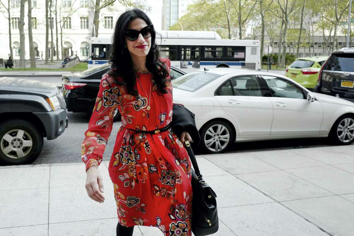 """In this Nov. 2, 2016, file photo, Huma Abedin is seen in the Brooklyn borough of New York. A person familiar with the investigation into Hillary Clinton's use of a private email server says Abedin did not forward """"hundreds and thousands"""" of emails to her husband's laptop, as FBI Director James Comey testified to Congress."""
