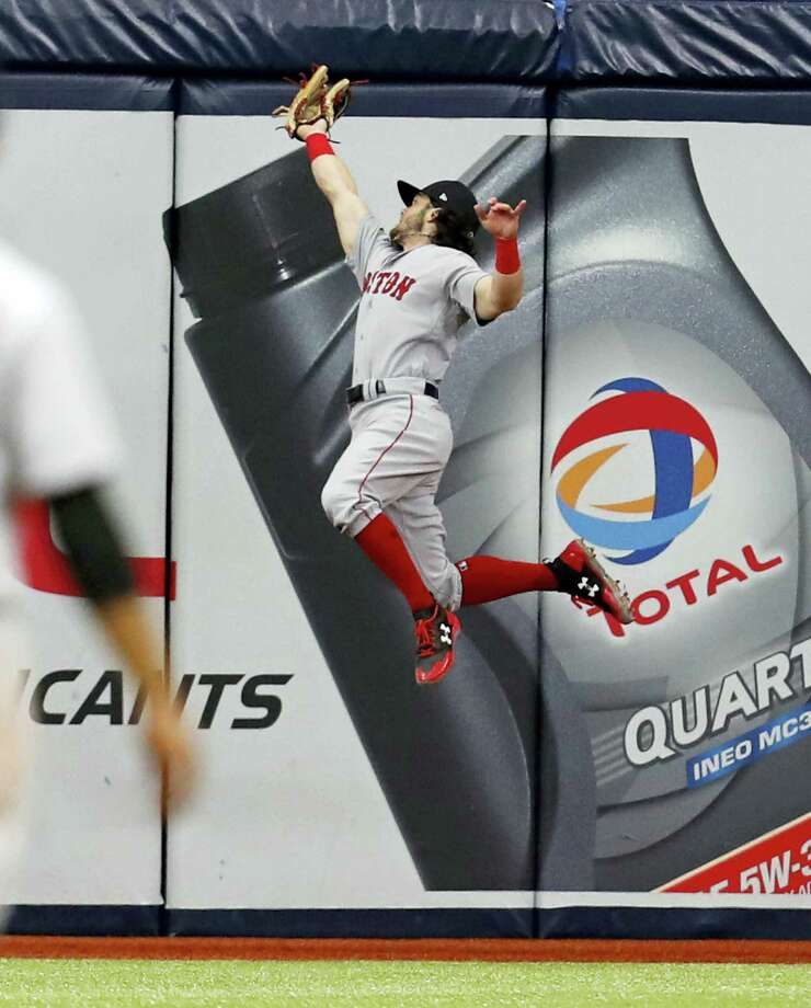 Red Sox center fielder Andrew Benintendi makes a leaping catch in the seventh inning Saturday in St. Petersburg, Fla. Photo: Mike Carlson — The Associated Press  / FR155492 AP