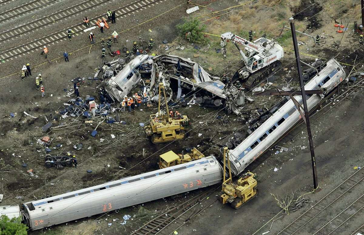 In this May 13, 2015, file photo, emergency personnel work near the wreckage of a New York City-bound Amtrak passenger train following a derailment that killed eight people and injured about 200 others in Philadelphia. Amtrak engineer Brandon Bostian won't be charged in the May 12, 2015, derailment, according to two lawyers for victims of the crash, Tom Kline and Robert Mongeluzzi. KYW-AM first reported Tuesday, May 9, 2017, that the lawyers say Bostian won't be charged.