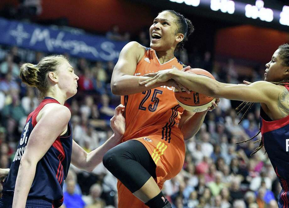 The Connecticut Sun's Alyssa Thomas, center, is fouled by the Mystics' Tierra Ruffin-Pratt, right, in the second half Saturday in Uncasville. Photo: Sean D. Elliot — The Day Via AP  / 2017 The Day Publishing Company