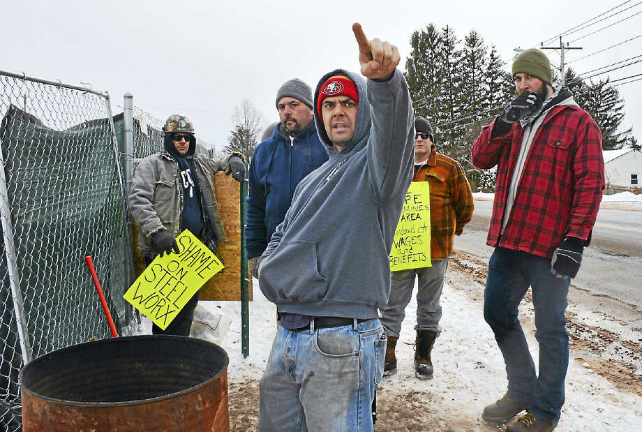 Members of the Ironworkers Local 15 stand in 20-degree temperatures to protest the hiring of local, nonunion employees as part of construction of the new FedEx distribution center on Middle Street near the Berlin town line. Photo: Cassandra Day — The Middletown Press