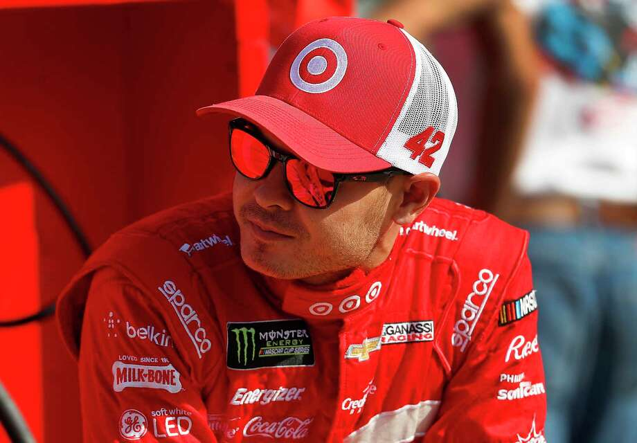 Kyle Larson talks with teammates prior to qualifying for the NASCAR Cup Series auto race in Brooklyn, Mich., Friday, Aug. 11, 2017. (AP Photo/Paul Sancya) Photo: Paul Sancya, STF / Copyright 2017 The Associated Press. All rights reserved.