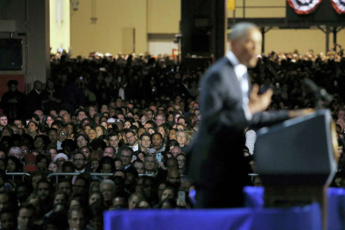 Supporters listen as President Barack Obama speaks at McCormick Place in Chicago, Tuesday, Jan. 10, 2017, giving his presidential farewell address.