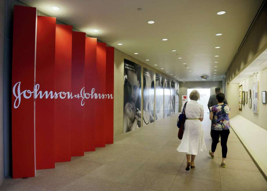 People walk along a corridor at the headquarters of Johnson & Johnson in New Brunswick, N.J. Photo: Mel Evans — The Associated Press File  / Copyright 2016 The Associated Press. All rights reserved. This material may not be published, broadcast, rewritten or redistribu