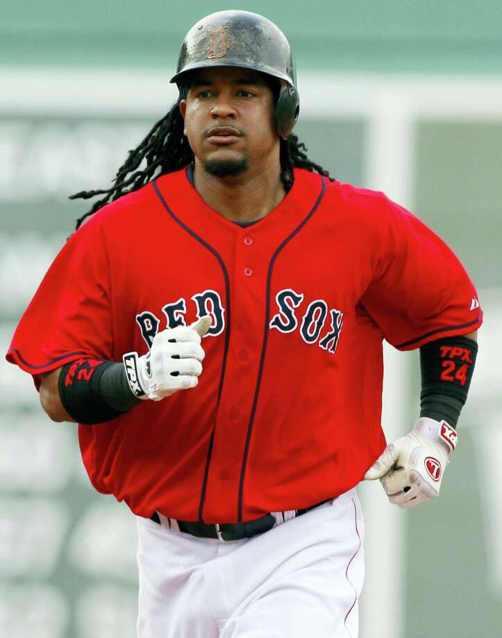 Boston Red Sox's Manny Ramirez jogs to the dugout after being forced out at second base in the first inning of a baseball game against the New York Yankees at Fenway Park in Boston. Photo: AP Photo/Elise Amendola, File  / AP2008