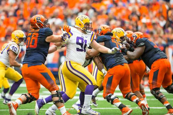 SYRACUSE, NY - SEPTEMBER 26:  Christian LaCouture #91 of the LSU Tigers pushes past Nick Robinson #68 of the Syracuse Orange on September 26, 2015 at The Carrier Dome in Syracuse, New York.  LSU defeats Syracuse 34-24.  (Photo by Brett Carlsen/Getty Images)