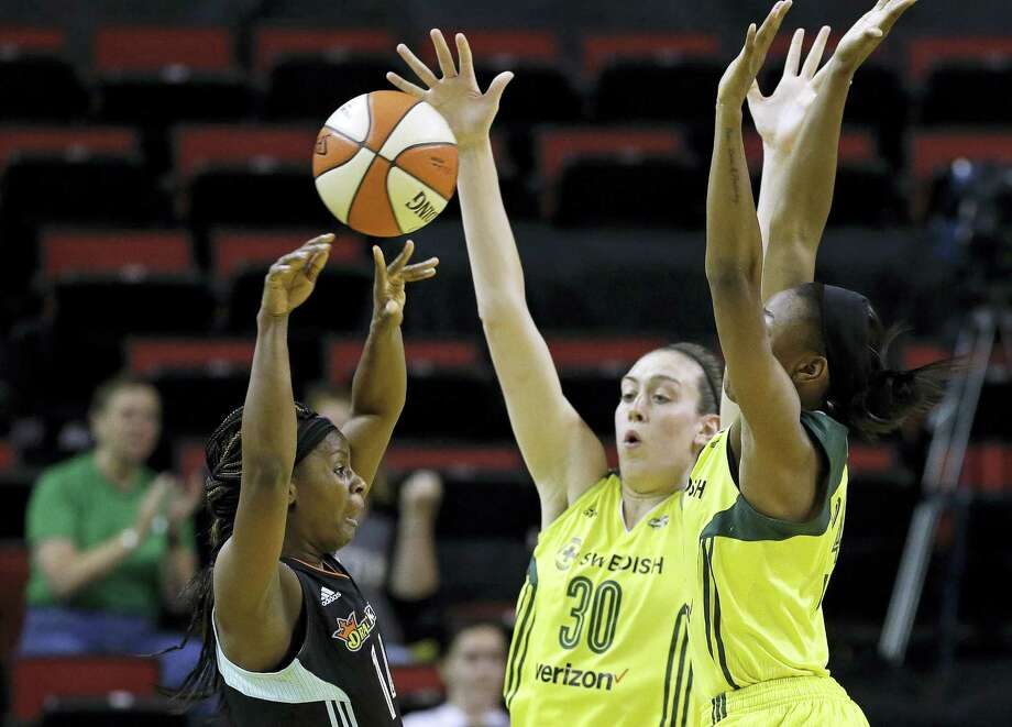The Storm's Jewell Loyd, right, and Breanna Stewart (30) double-team the Liberty's Sugar Rodgers during a recent game in Seattle. Photo: Elaine Thompson — The Associated Press  / Copyright 2017 The Associated Press. All rights reserved.