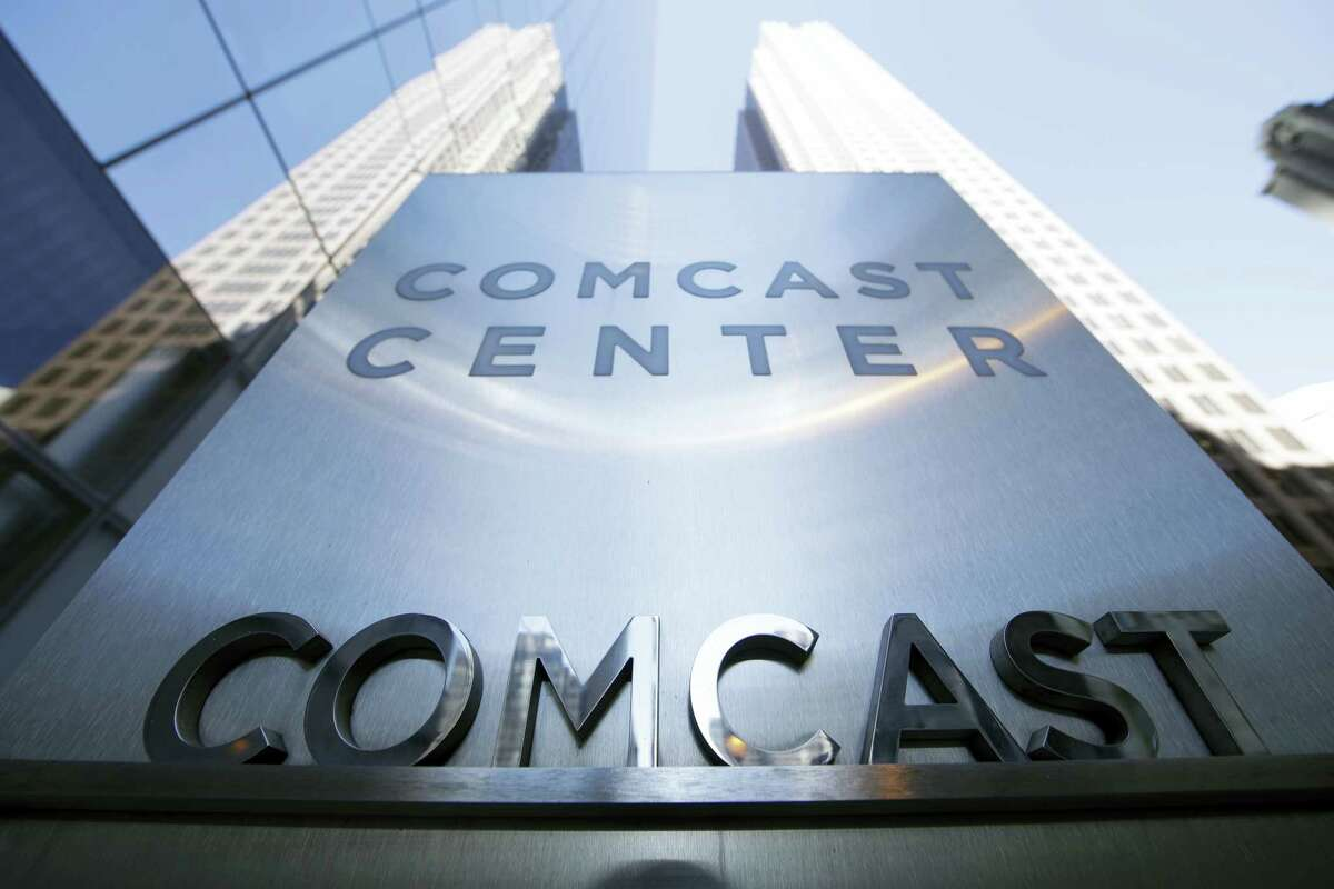 This March 29, 2017 photo shows a sign outside the Comcast Center in Philadelphia. Cable operators Comcast and Charter Communications have agreed to form a wireless partnership in order to strengthen their positions in the rapidly growing sector. Comcast and Charter Communications Inc. said Monday, May 8, that their partnership will give customers more choice and competitive prices.
