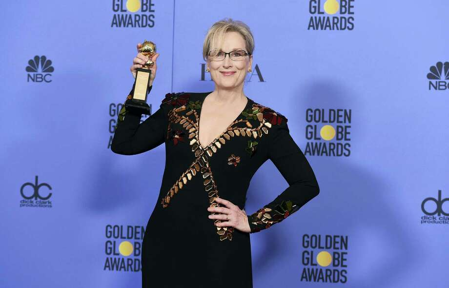 Meryl Streep poses in the press room with the Cecil B. DeMille award at the 74th annual Golden Globe Awards at the Beverly Hilton Hotel on Sunday, Jan. 8, 2017, in Beverly Hills, Calif. Photo: Photo By Jordan Strauss — Invision/AP / 2017 Invision