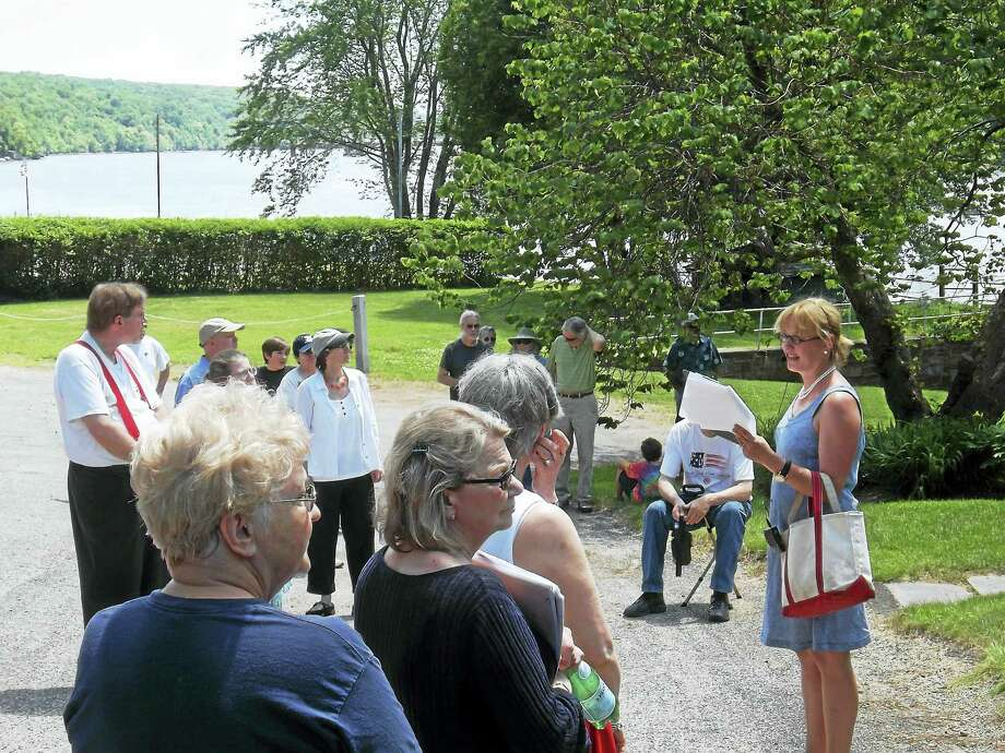 "Photo Caption- Middle Haddam historian Margaret Faber (right) leading a walk at Knowles Landing. It was a nationally significant port for shipbuilding and commerce from the 1730s – 1880s. The Chatham Historical Society is organizing a walking tour of Middle Haddam on Sunday, July 16th, at 1 pm as part of its ""Explore East Hampton"" monthly series of walks. Come for a walk back in time and learn about the history of shipbuilding in Middle Haddam. The walk is sponsored by the East Hampton Parks and Recreation. Chatham Historical Society member, Margaret McCutcheon Faber, will lead the walk. She has lived in Middle Haddam all her life and has served on the State of Connecticut's Historic Preservation Council in Hartford for the past 7 years.  Margaret has a strong interest in Middle Haddam's history and is delighted to share it with others. Come and learn about how Middle Haddam was established and served as an important port on the Connecticut River between 1730 and 1880, acting as a shipment point for trade with the West Indies and the North American coast, and as the site of shipyards building ocean-going vessels. It has a picturesque and colorful history of sea captains, ship building, and commerce. Knowles Landing was home to more than a dozen sea captains and several large ship yards. In each yard up to six ships were built a year and many transported goods from New York City to the West Indies, and Europe.  Margaret will take the walkers down Blacksmith Rd. to the shipyards, up Knowles Road and south on Middle Haddam Road, to point out significant buildings and sites, before returning to Long Hill Road.  The Walking Tour offers a wonderful and unique opportunity for new residents to learn about the history of Middle Haddam and for life-long residents to share their recollections and stories. Adults and children are welcome to join in what promises to be an afternoon of making local history come alive. Directions: Go to the intersection of Rts. 66 and 151 in Photo: CREDIT HERE / COPYRIGHT,2011"