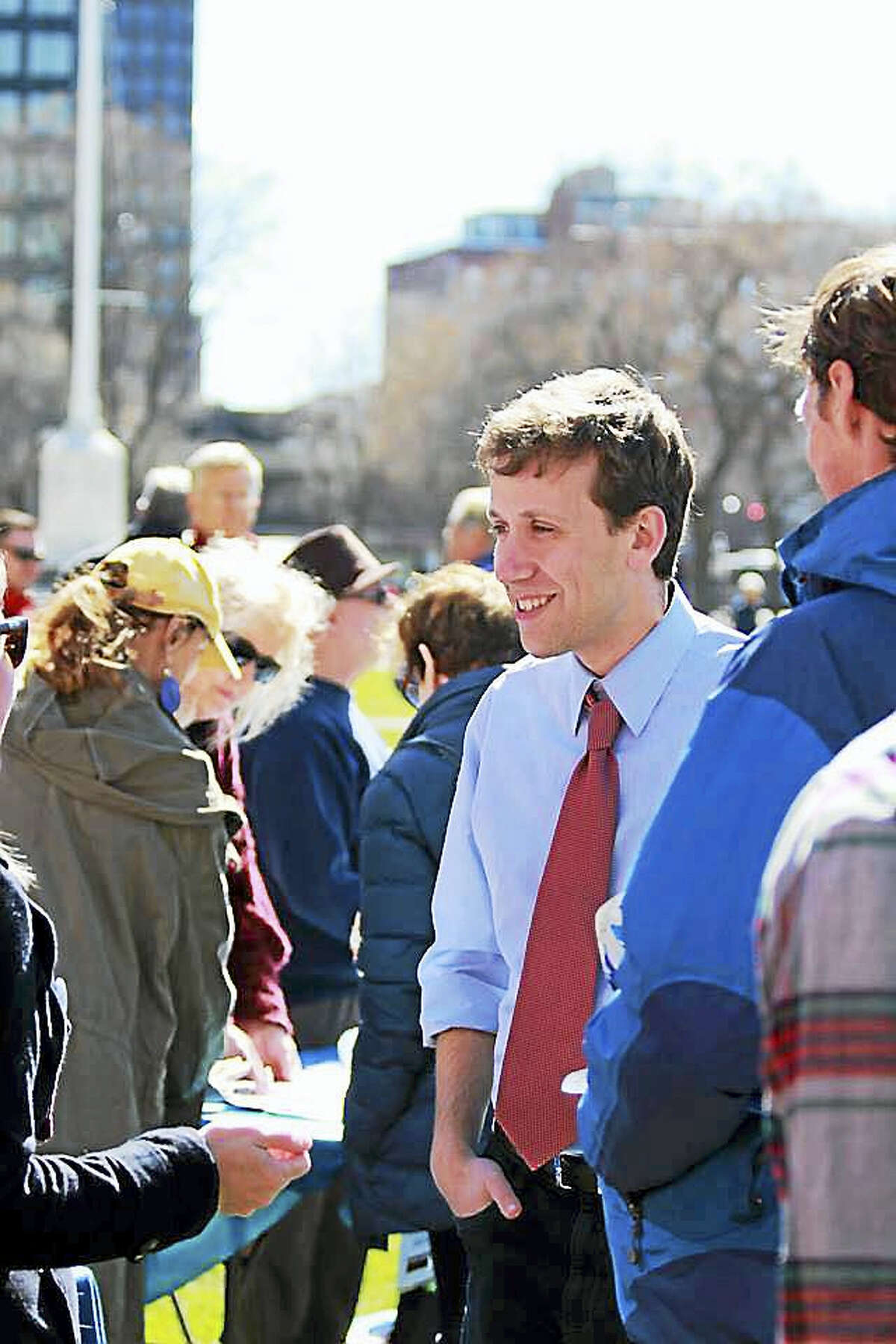State Rep. Matthew Lesser, D-Middletown, greets constituents in New Haven recently. He's formed an exploratory committee for a possible run for secretary of state and just released his July 10 filings with the State Elections Enforcement Commission.