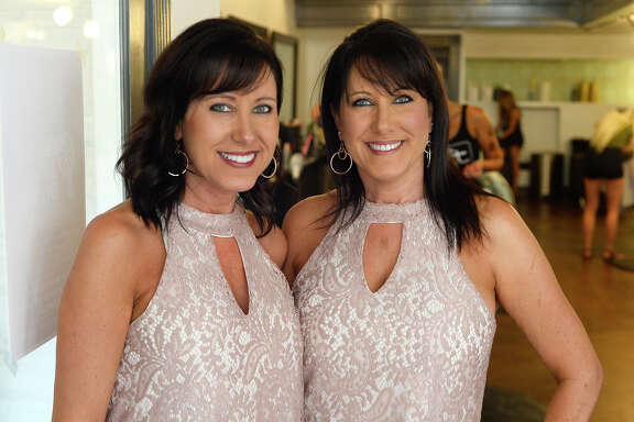 Twin sisters Paulette Shaver and Pauline Ogden during the 4th annual Blow Dry Bar to benefit Ubi Caritas at The Loft Hair Studio on Friday. The organization provides community health programs such as education for diabetics and new mothers.  Photo taken Friday 8/11/17 Ryan Pelham/The Enterprise
