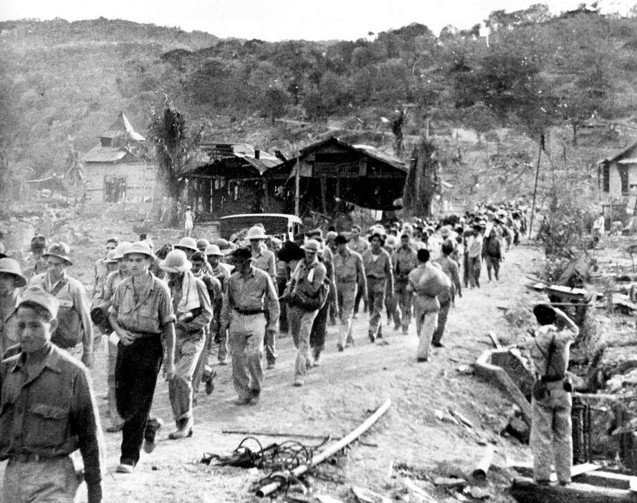 In this 1942 file photo American and Filipino prisoners of war captured by the Japanese are shown at the start of the Death March after the surrender of Bataan on April 9 near Mariveles in the Philippines, during World War II. Hundreds of American soldiers and thousands of Filipinos died along the way. Survivors of a brutal World War Two death march to a prison camp will be on hand Saturday, April 8, 2017, in San Francisco's Presidio to commemorate an event its largely Filipino-American organizers hope will not be lost to history. Photo: AP Photo/File   / AP1942