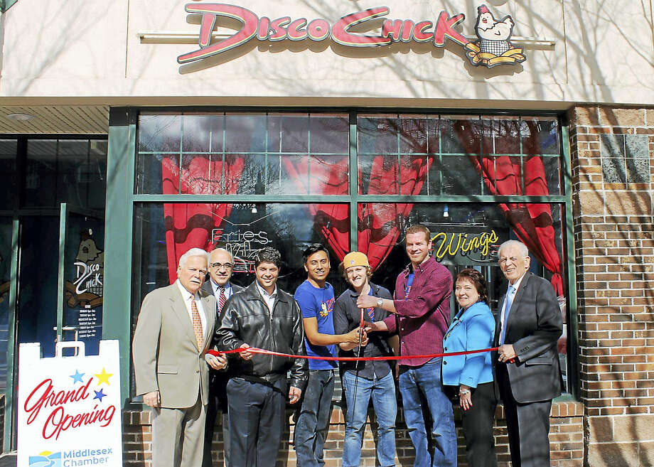 A grand opening of Disco Chick was held in Middletown April 5. From left are Middletown Small Business Development Counselor Paul Dodge, Middletown Economic Development Specialist Thomas Marano, Middletown Mayor Dan Drew, Disco Chick General Manager Alex Holderman, Disco Chick co-owner John Schauster, Disco Chick co-owner Michael Boney, chairwoman of the Downtown Business District Diane Gervais and President of the Middlesex County Chamber of Commerce Larry McHugh. Photo: Contributed Photo