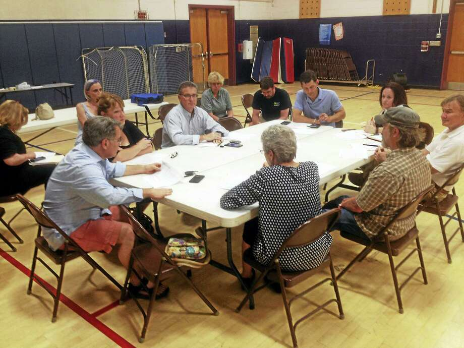 The East Hampton Board of Finance set the new mill rate following Tuesday night's $44.26 million budget referendum. Photo: Jeff Mill — The Middletown Press