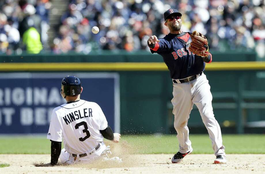 Red Sox second baseman Dustin Pedroia throws to first to complete a double play in the third inning as the Tigers' Ian Kinsler slides into second on Friday. Photo: Carlos Osorio — The Associated Press  / Copyright 2017 The Associated Press. All rights reserved.