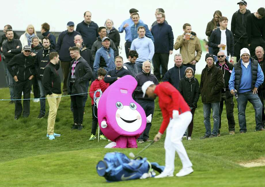 A mascot is displayed as Denmark's Lucas Bjerregaard prepares to take a shot during day one of the GolfSixes at the Centurion Club, in St Albans, England on Saturday. Photo: Steve Paston — PA Via AP  / PA Wire