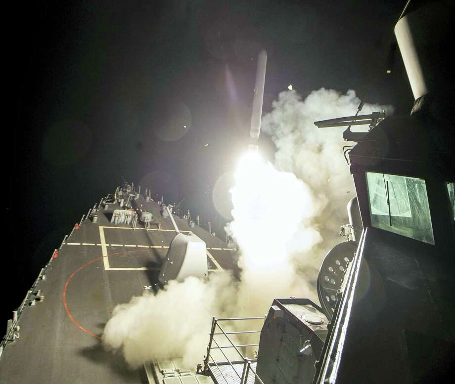 In this image provided by the U.S. Navy, the USS Ross (DDG 71) fires a tomahawk land attack missile Friday, April 7, 2017, from the Mediterranean Sea. The United States blasted a Syrian air base with a barrage of cruise missiles in fiery retaliation for this week's gruesome chemical weapons attack against civilians. Photo: Mass Communication Specialist 3rd Class Robert S. Price/U.S. Navy Via AP / U.S. Navy