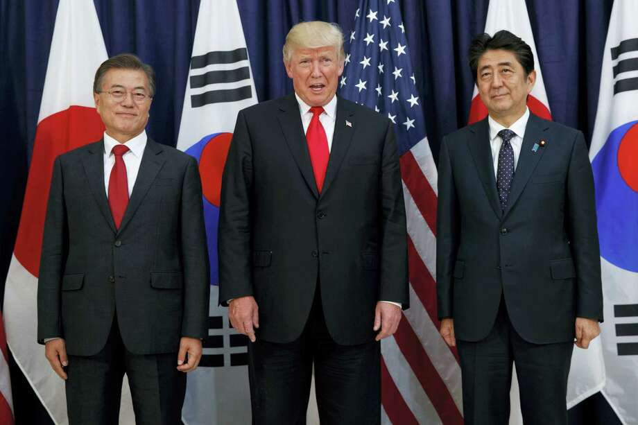 President Donald Trump meets with Japanese Prime Minister Shinzo Abe, right, and South Korean President Moon Jae-in before the Northeast Asia Security dinner at the US Consulate General Hamburg, Thursday, July 6, 2017, in Hamburg. Photo: Evan Vucci / AP Photo  / Copyright 2017 The Associated Press. All rights reserved.