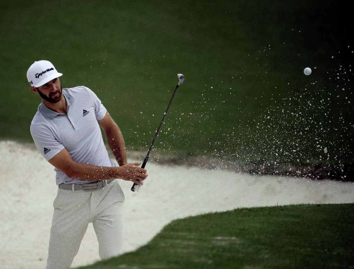 Dustin Johnson hits from a bunker on the 10th hole during a practice round for the Masters golf tournament Wednesday in Augusta, Ga.