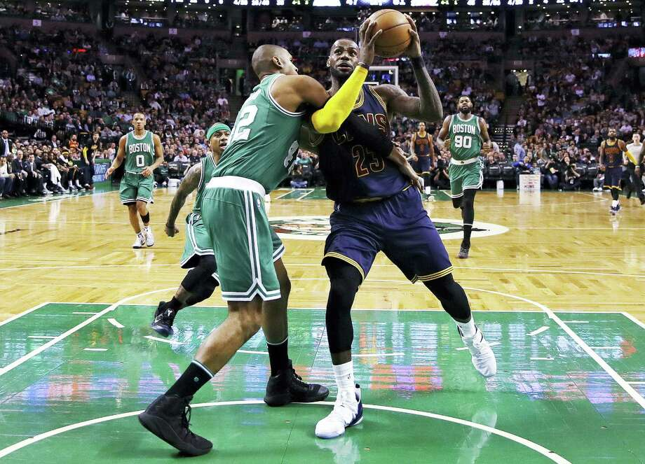 Cleveland Cavaliers forward LeBron James, right, is fouled by Boston Celtics center Al Horford during the third quarter of an NBA basketball game in Boston, Wednesday, April 5, 2017. (AP Photo/Charles Krupa) Photo: AP / Copyright 2017 The Associated Press. All rights reserved.