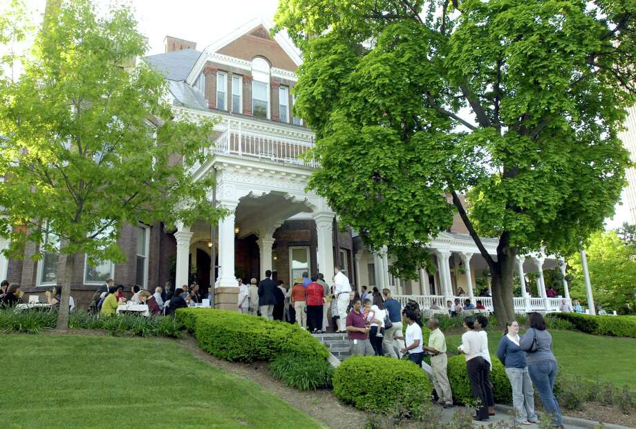 In this May 22, 2007 file photo, residents from the neighborhood gather for a cookout at the governor's residence in Albany, N.Y. New York Gov. Andrew Cuomo says spooky sounds keep him awake at night when he stays at the governor's mansion in Albany. The Democrat told a Long Island crowd Thursday, May 4, 2017,  that during legislative sessions he spends evenings awake and unsettled by unexplained noises in the 161-year-old mansion near the Capitol building. Photo: AP Photo/Tim Roske, File   / Copyright 2017 The Associated Press. All rights reserved.
