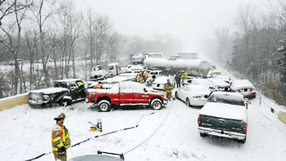 Connecticut State Police Trooper Kelly Grant Pileup Saturday on Interstate 91 southbound near Exit 21 and 22. Twenty cars, three tractor-trailers and a tanker were involved. No serious injuries were reported. Photo: Digital First Media