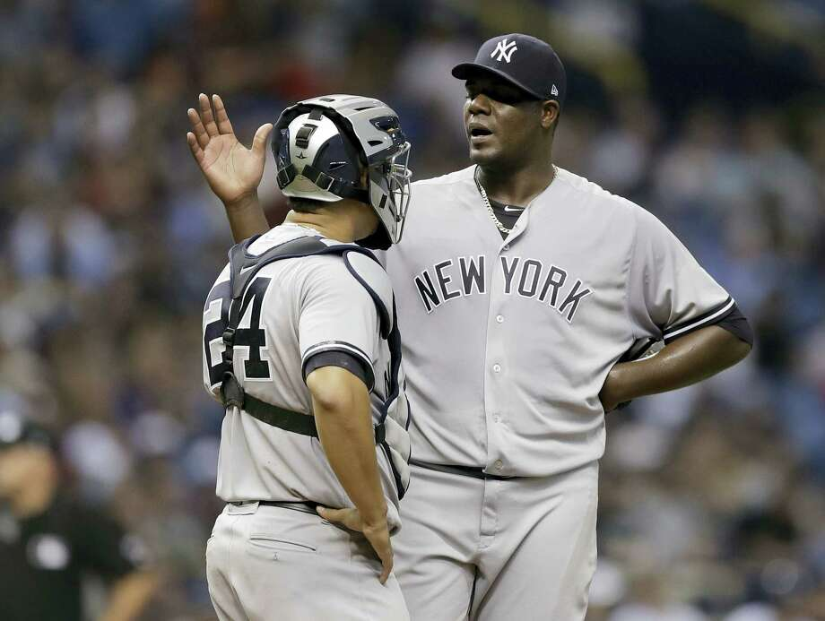New York Yankees starting pitcher Michael Pineda talks to catcher Gary Sanchez (24) as he struggles against the Tampa Bay Rays during the second inning of a baseball game, Wednesday in St. Petersburg, Fla. Photo: Chris O'Meara — The Associated Press  / Copyright 2017 The Associated Press. All rights reserved.