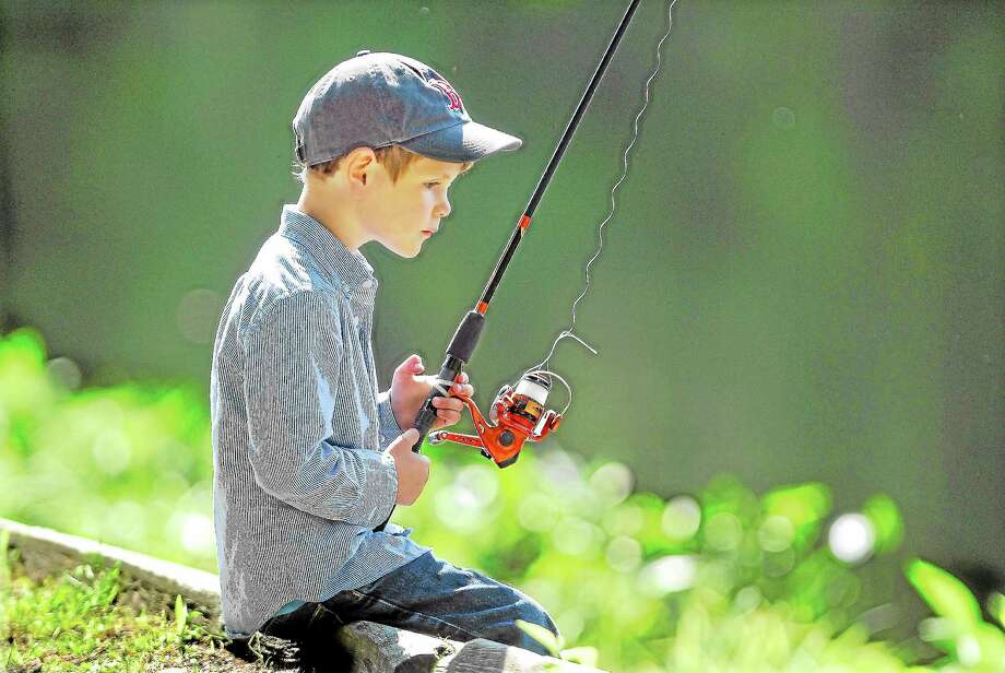 Catherine Avalone | File photo A young boy fishes at Chatfield Hollow in Killingworth. Photo: Journal Register Co.