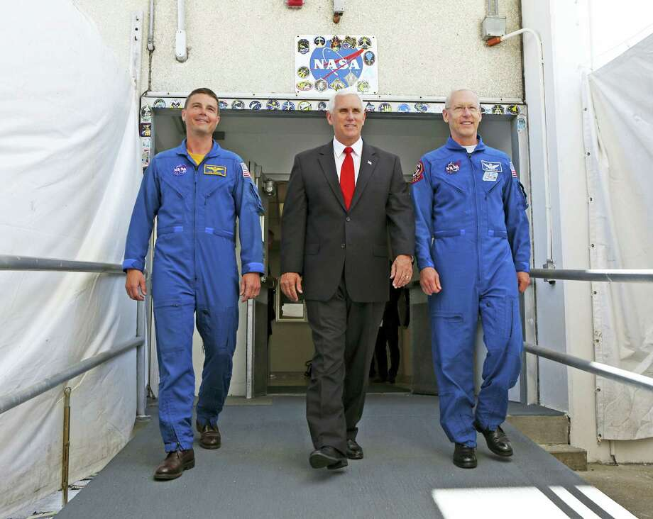 Vice President Mike Pence, center, is flanked by NASA astronaut Reid Wiseman, left, and Patrick Forrester, NASA Chief astronaut as they walk out of crew headquarters at the Kennedy Space Center in Cape Canaveral, Fla., on Thursday, July 6, 2017. Pence is leading a newly revived National Space Council. Photo: Red Huber / Orlando Sentinel Via AP  / Orlando Sentinel