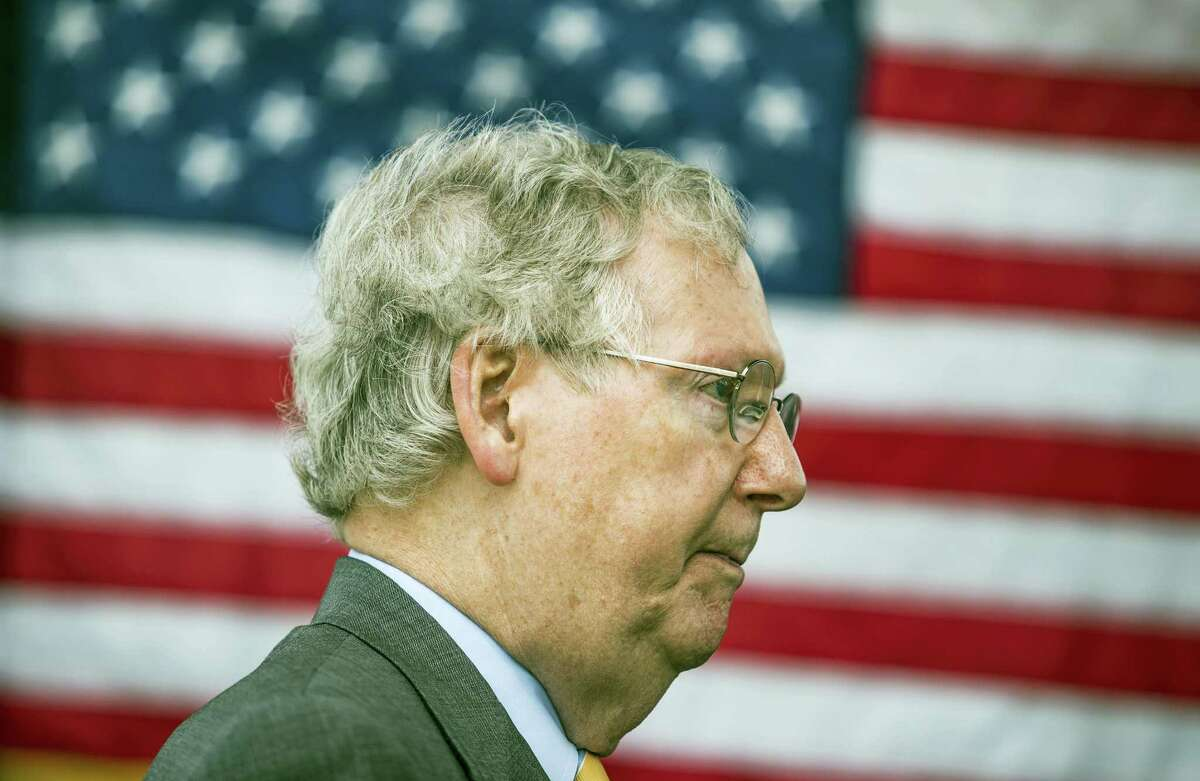 U.S. Sen. Mitch McConnell, R-Ky., speaks to members of the media after a ribbon cutting ceremony for exit 30 on Interstate 65 in Bowling Green, Ky., on Thursday, July 6, 2017.