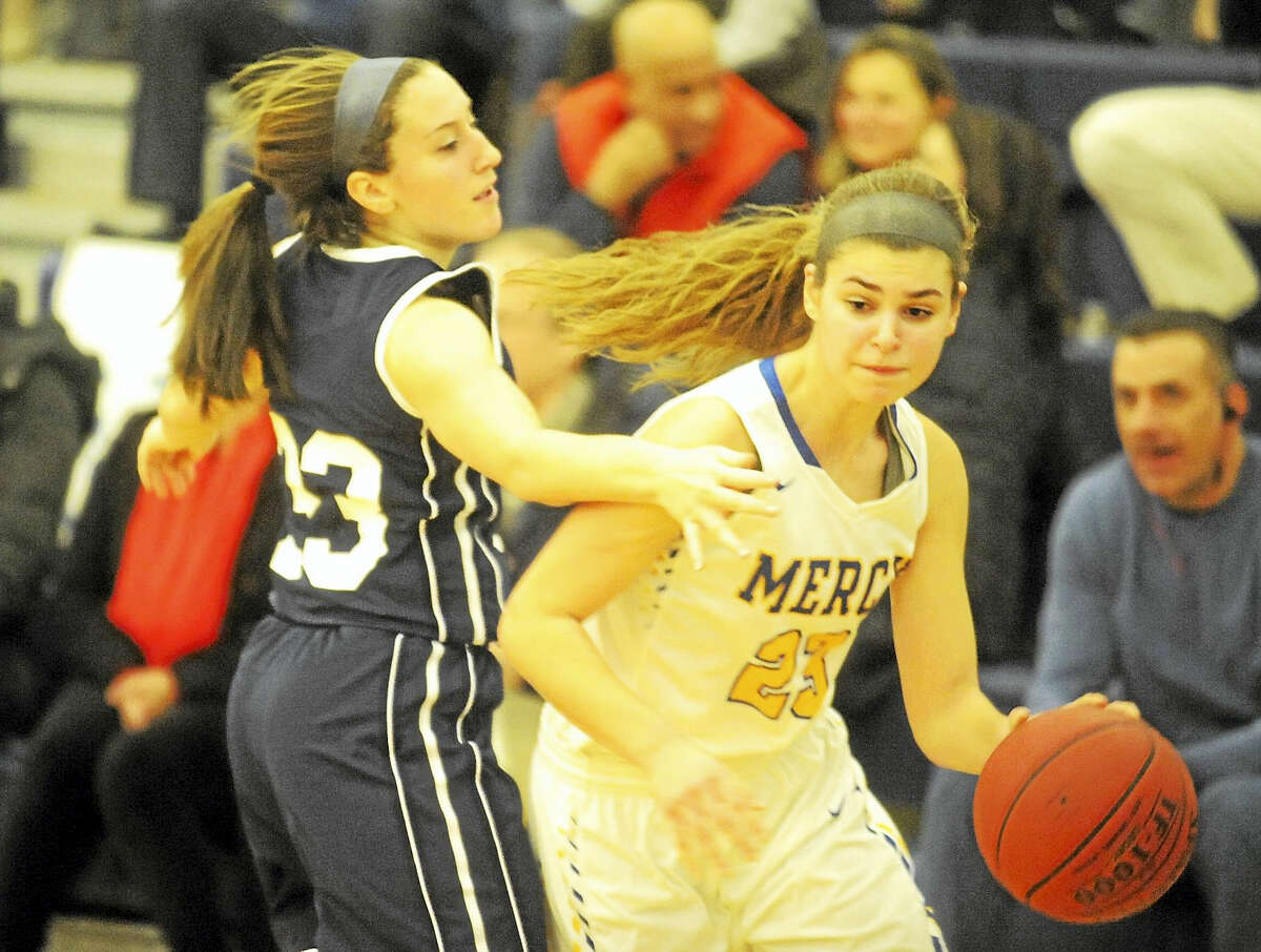 Mercy junior Samantha Chapps looks to drive past Lauralton Hall's Lauren Adams during the first half Friday night in Middletown.