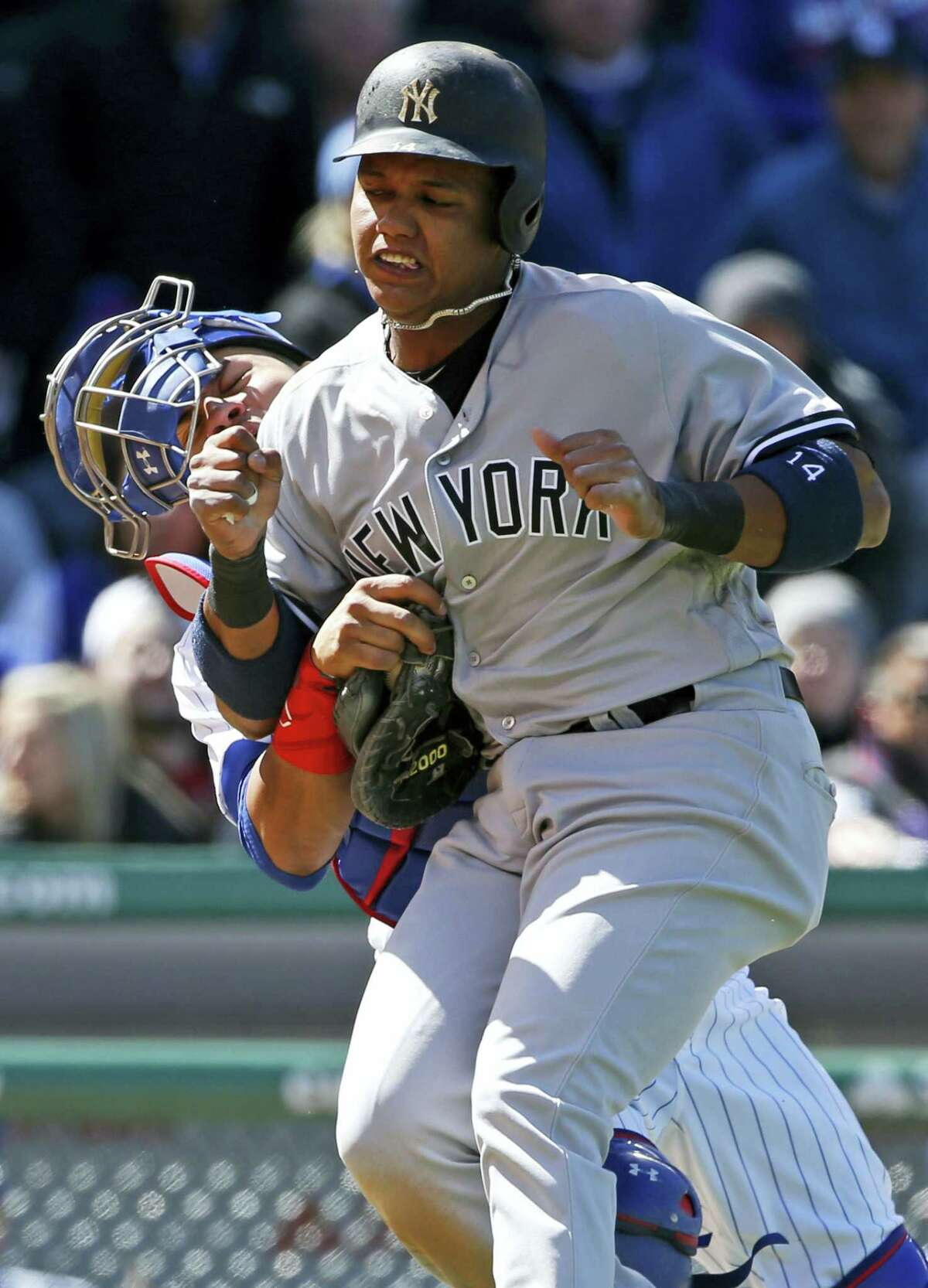 Cubs catcher Willson Contreras, left, tags out the Yankees' Starlin Castro as they collide in the sixth inning Friday.