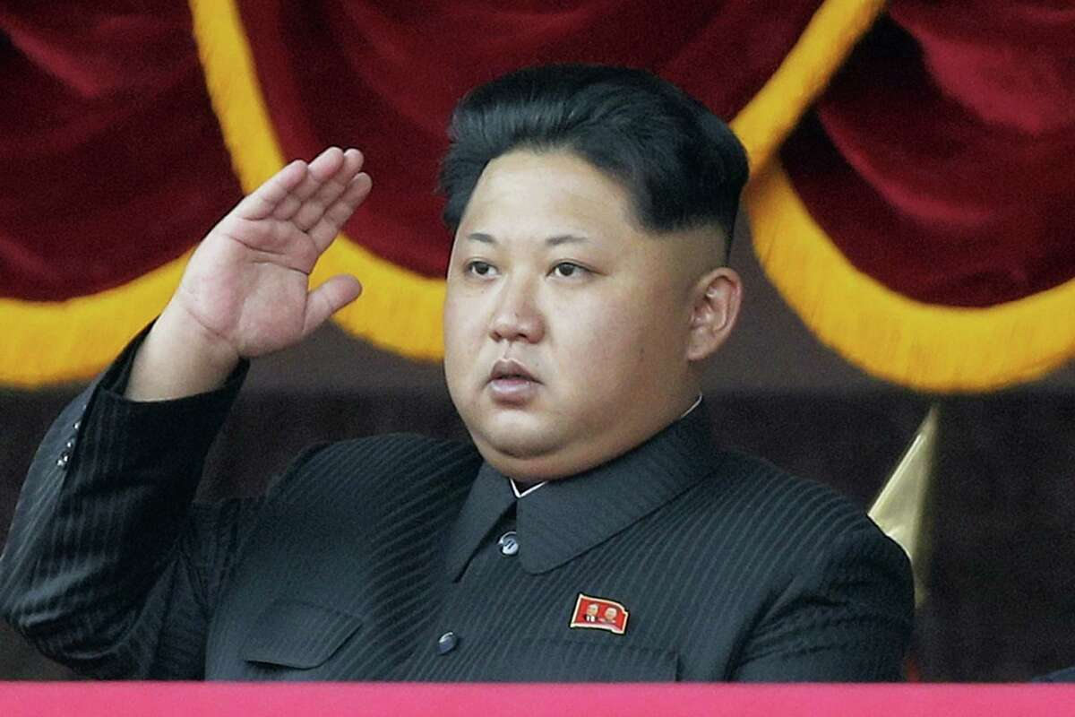 North Korean leader Kim Jong Un salutes at a parade in Pyongyang, North Korea.